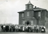Children standing in front of Mitchell schoolhouse